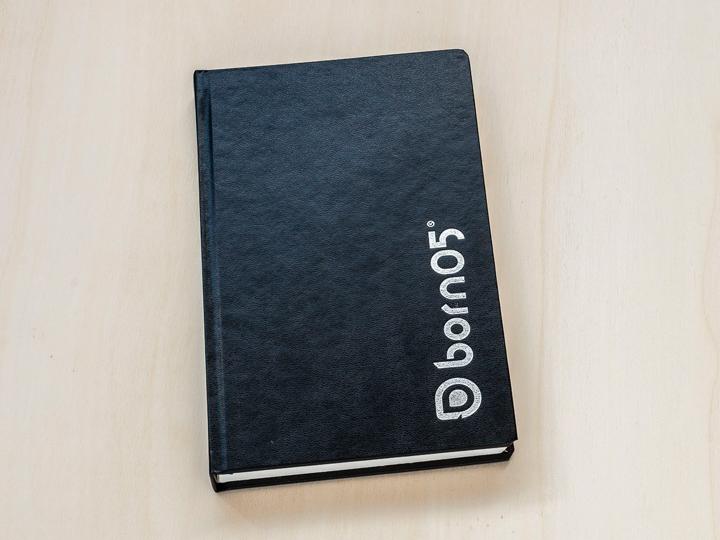 nottieboek met logo in zilver